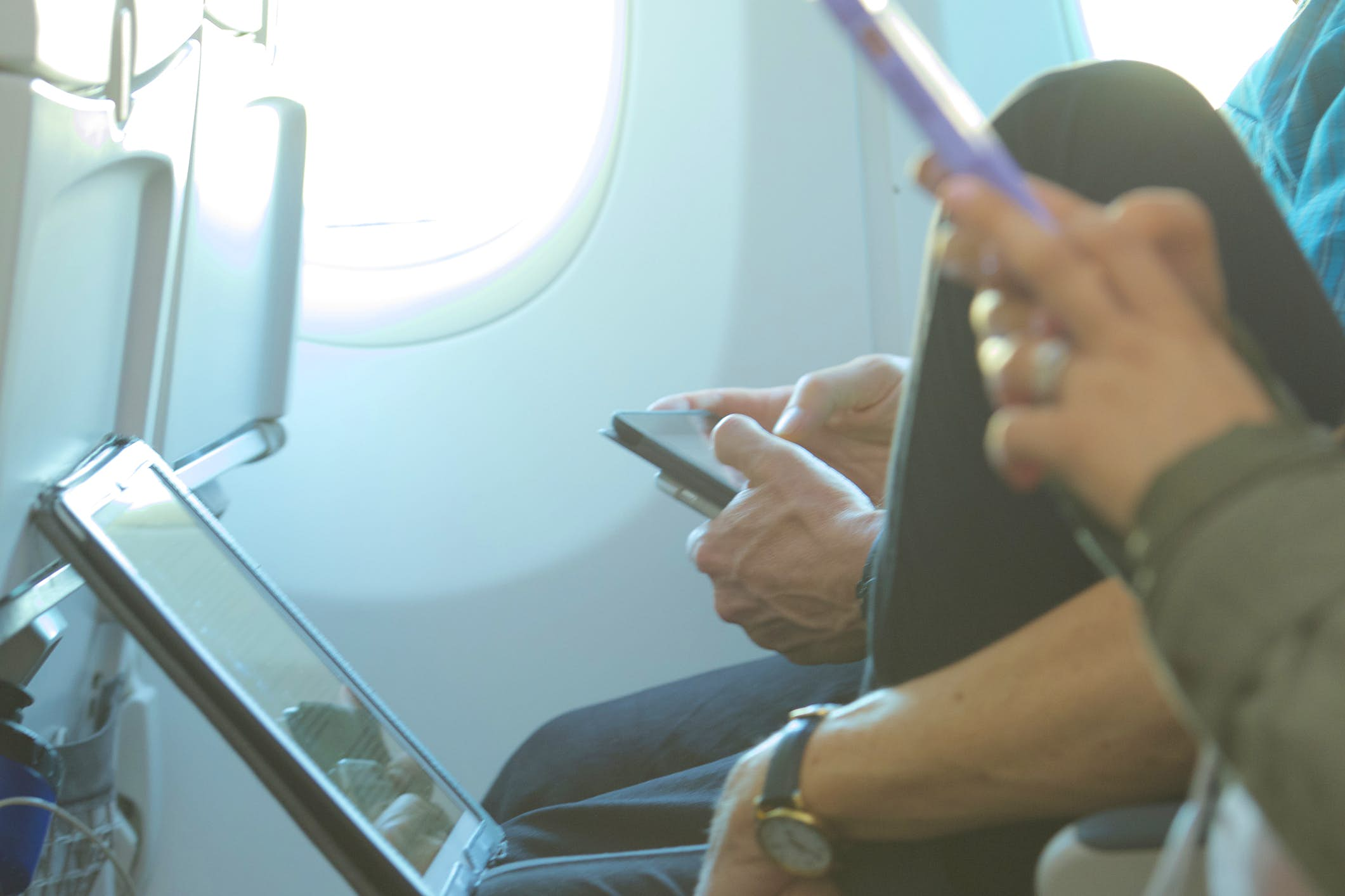 Travel News - laptops and smartphones in airplane seat