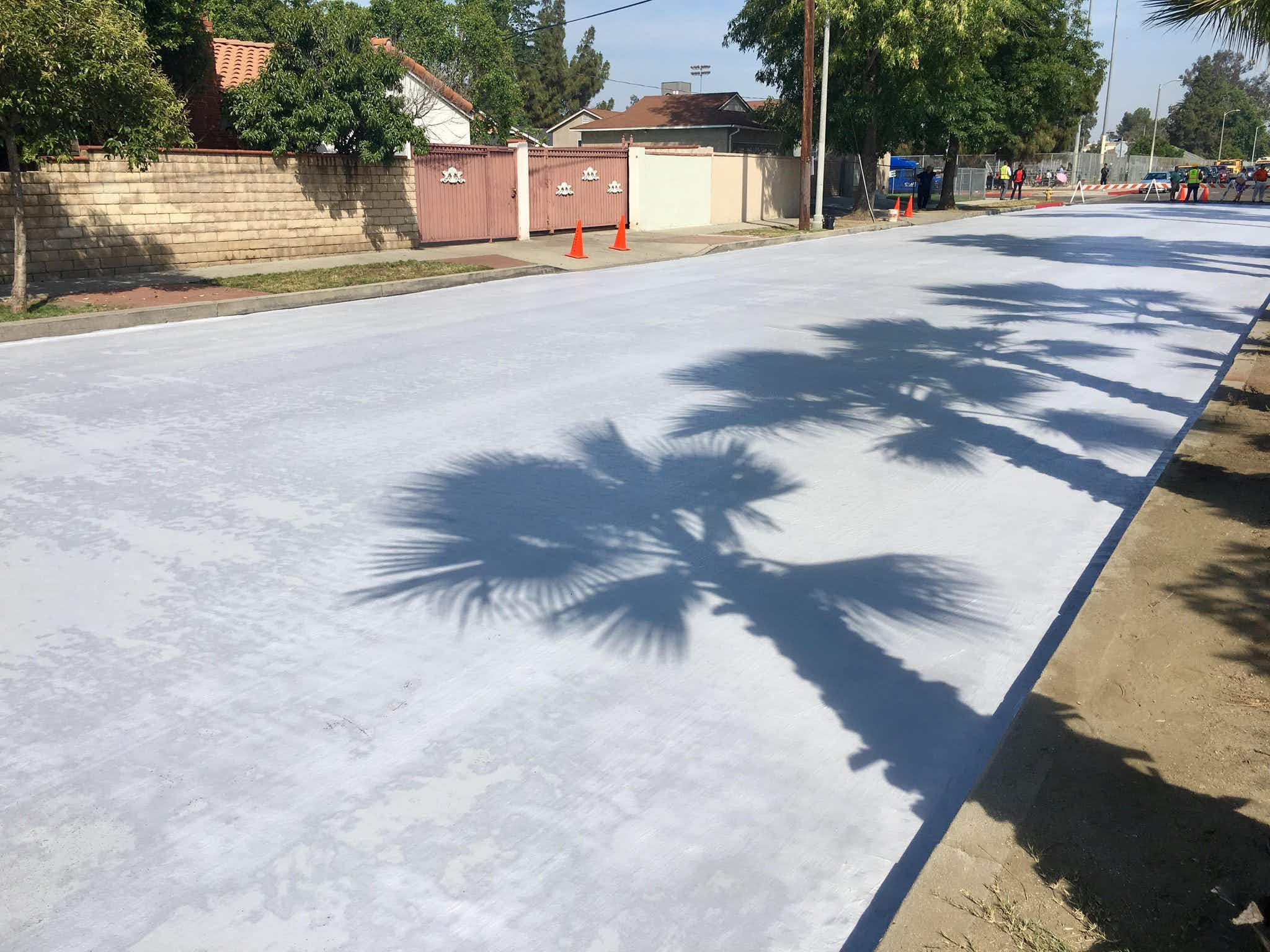 LA paints the streets white to cool them down in soaring summer temperatures