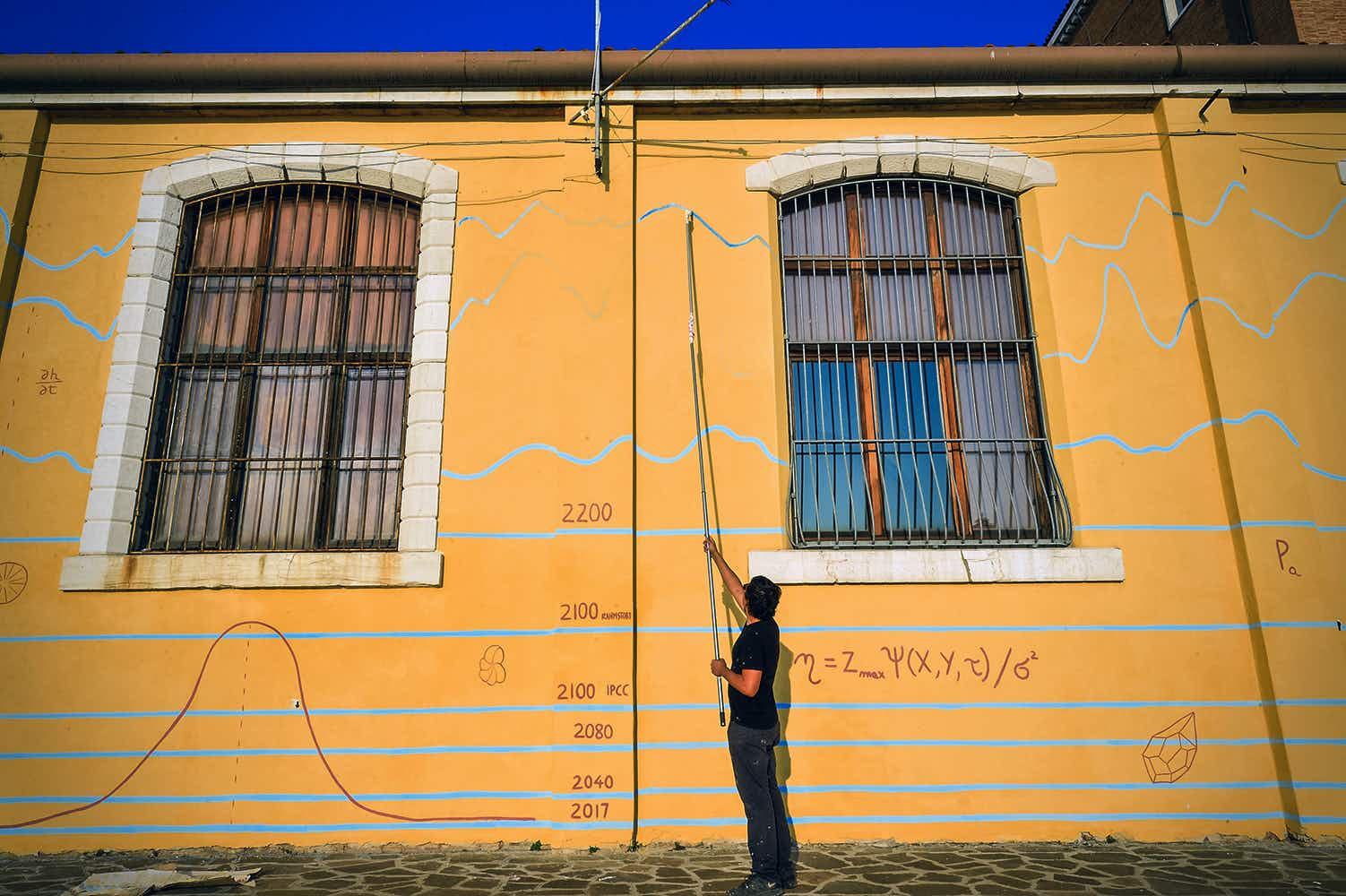 Artist uses façade of dockside building in Venice to address climate change