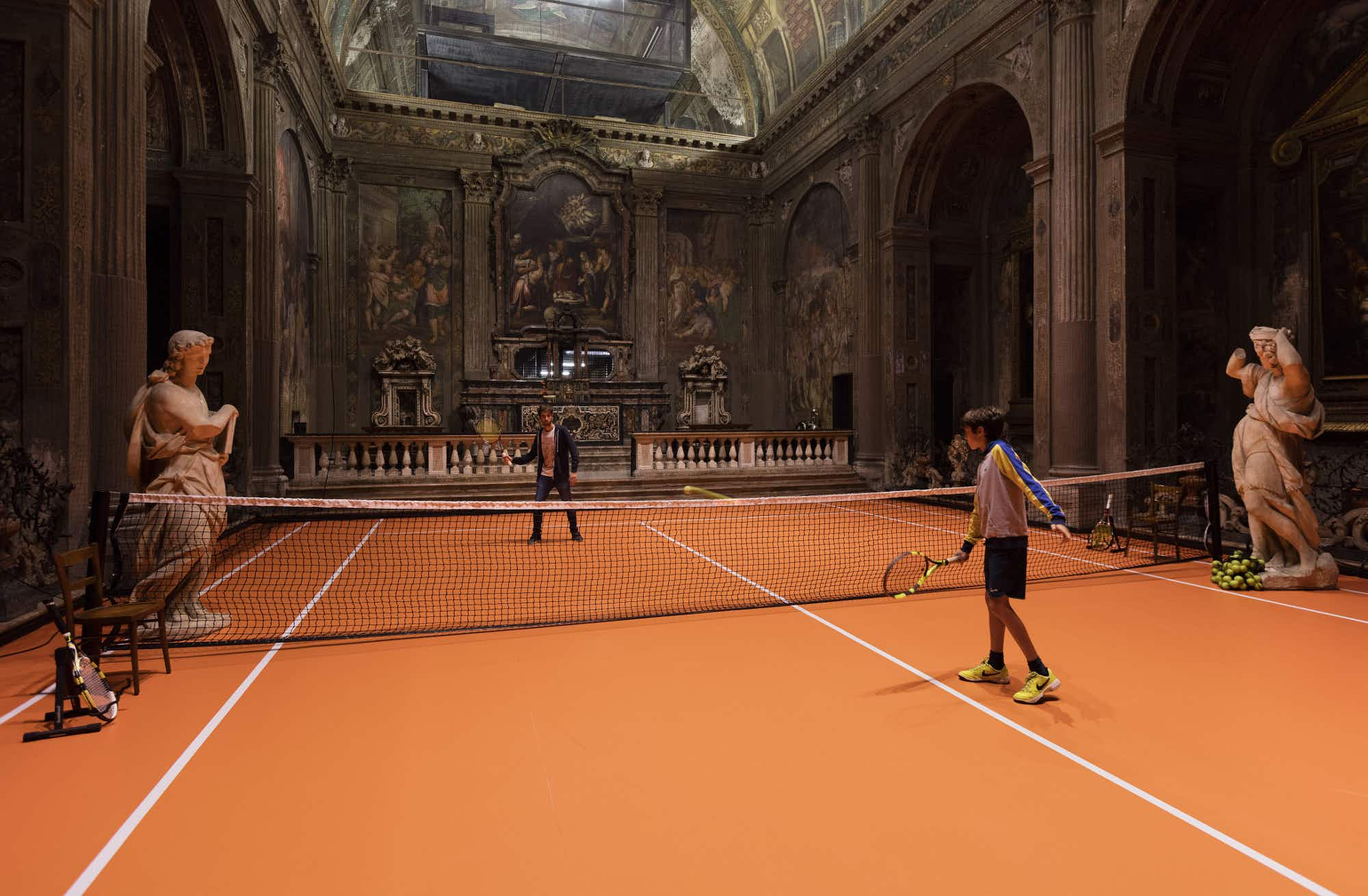 Practice your serve at a tennis court inside a 16th century church in Milan