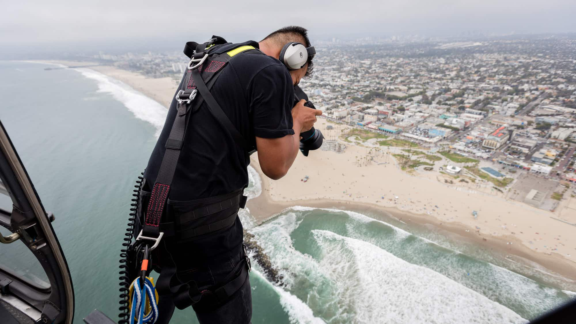 Photographer shares stunning images he takes hanging from a helicopter