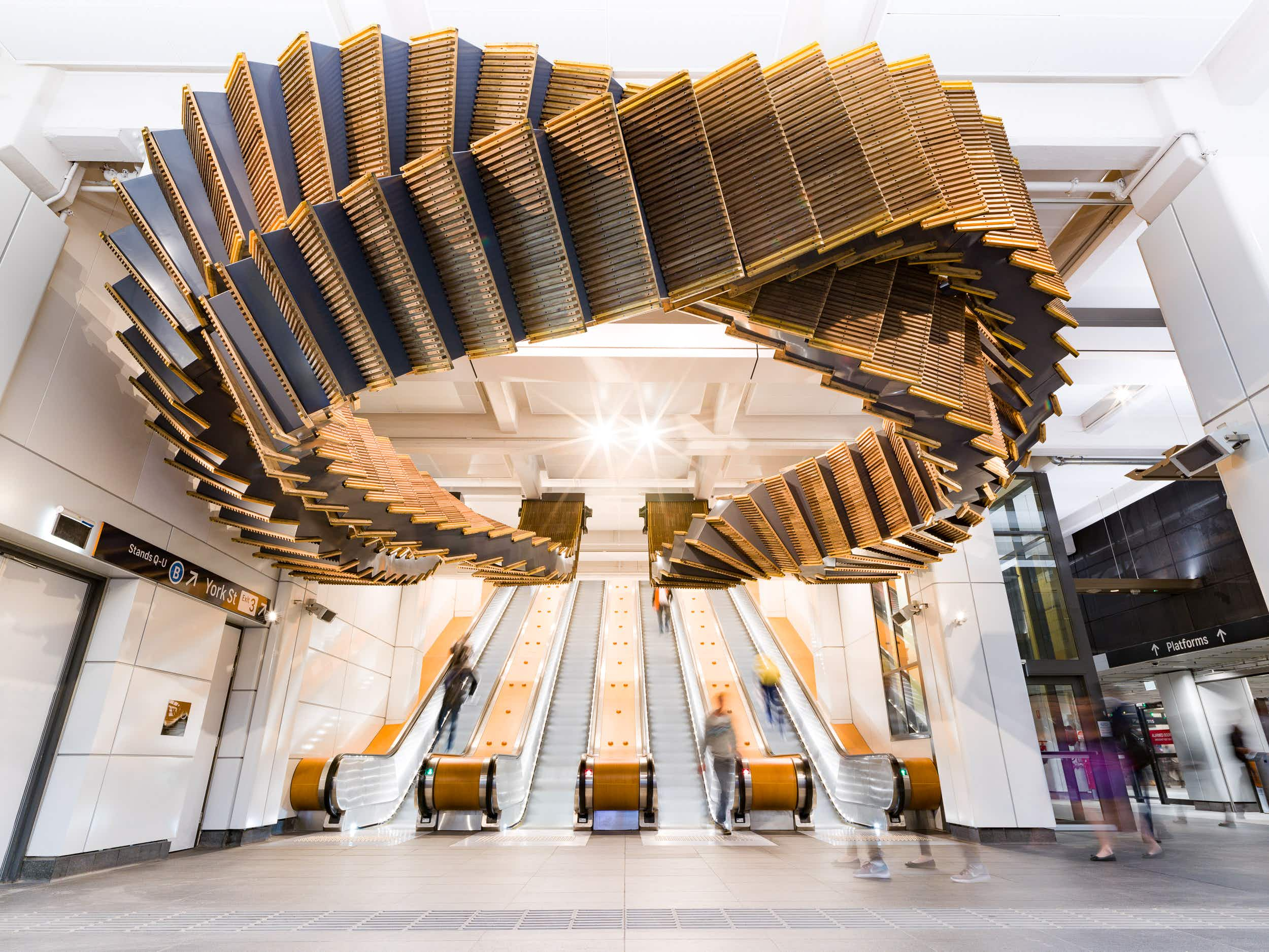 This mesmerising winding staircase floats over commuters' heads in a Sydney station