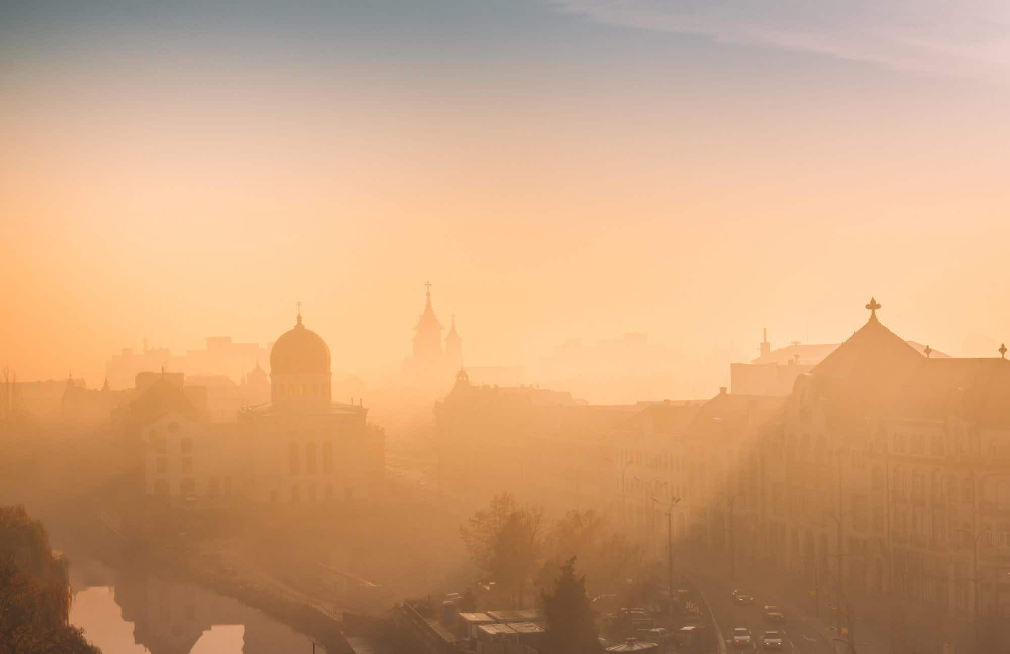 Photographer captures Romanian city bathed in fog