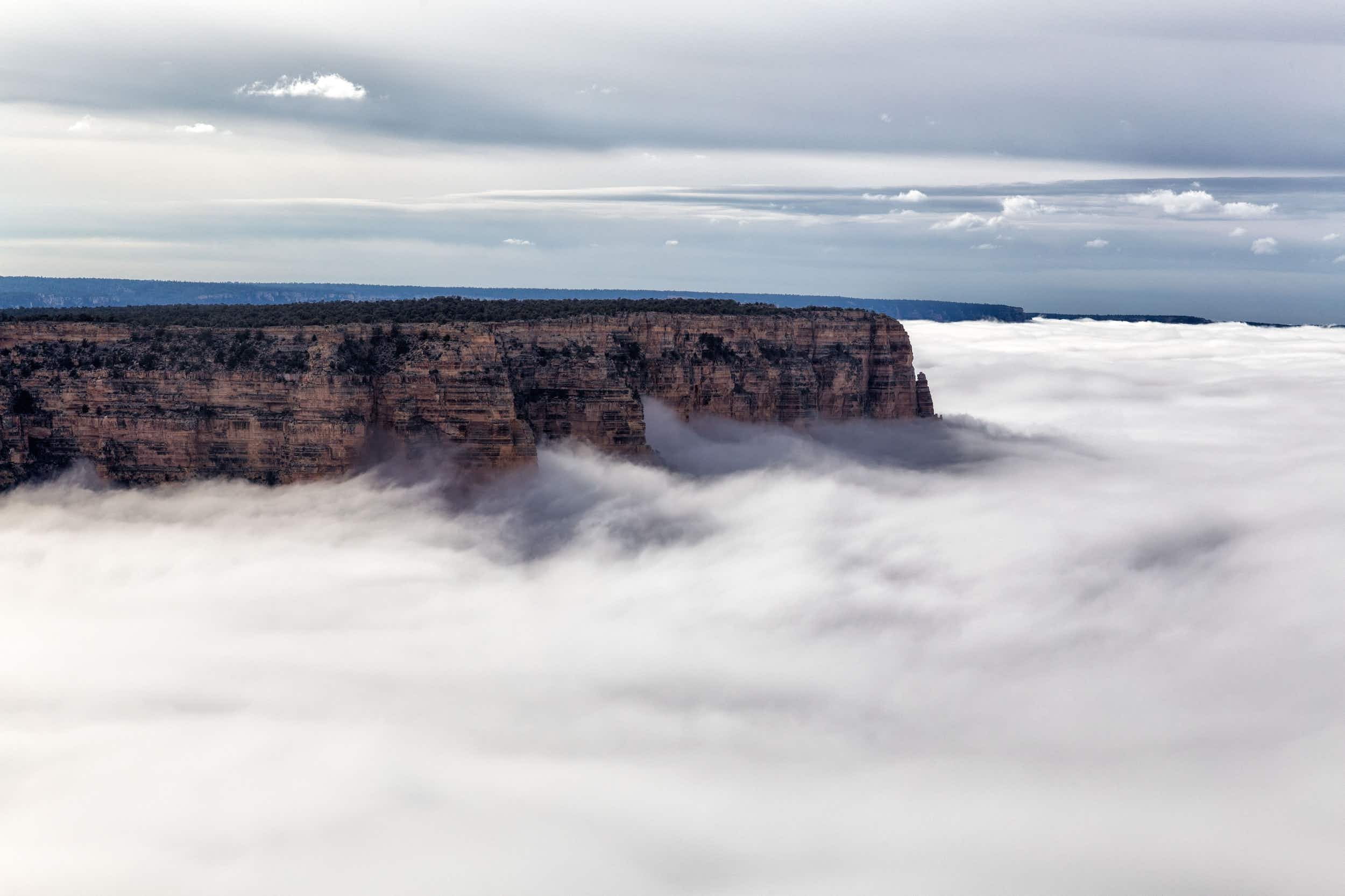 Stunning time-lapse footage shows Grand Canyon cloaked in rare, rolling clouds