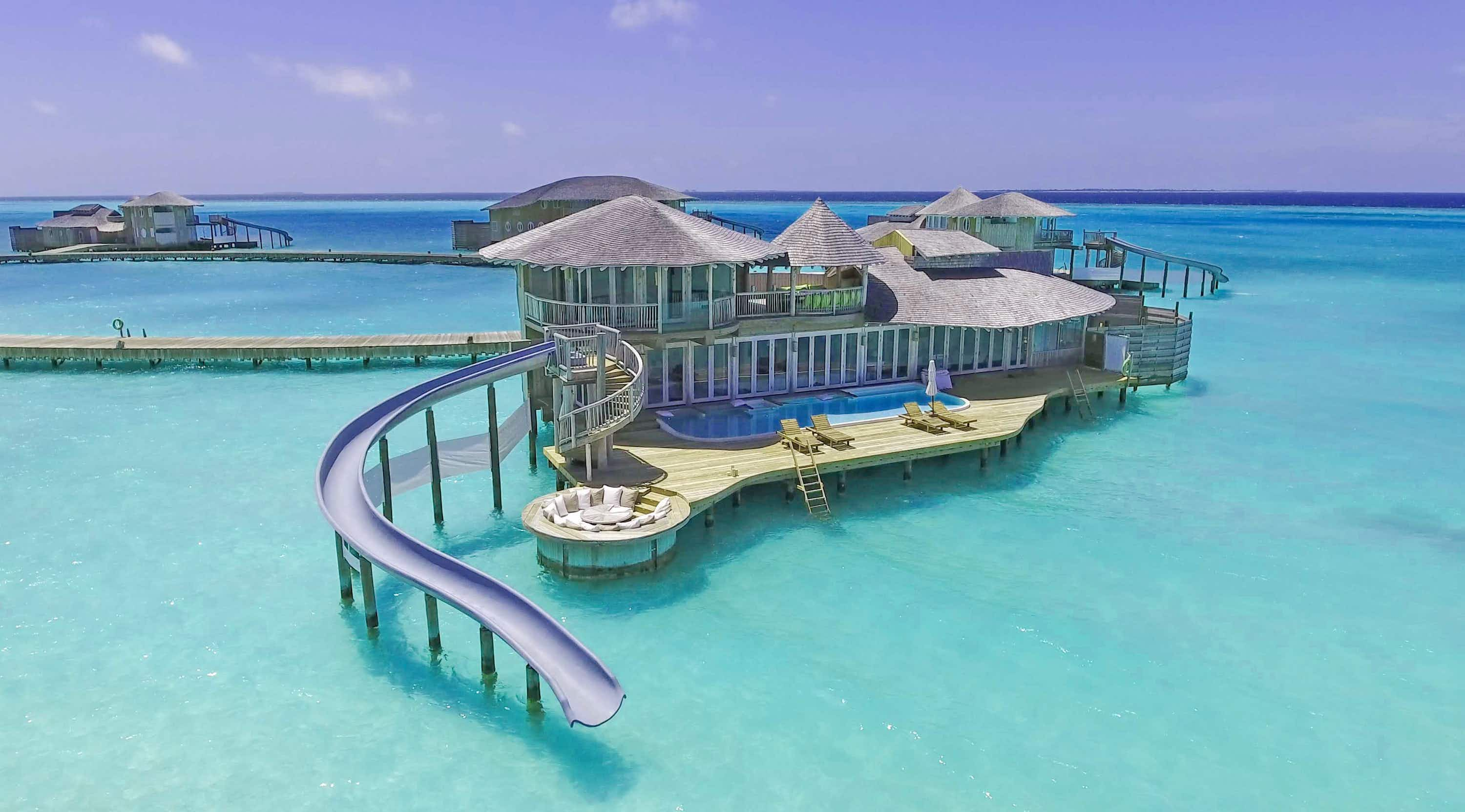 These villas in the Maldives have slides to take you right into the water