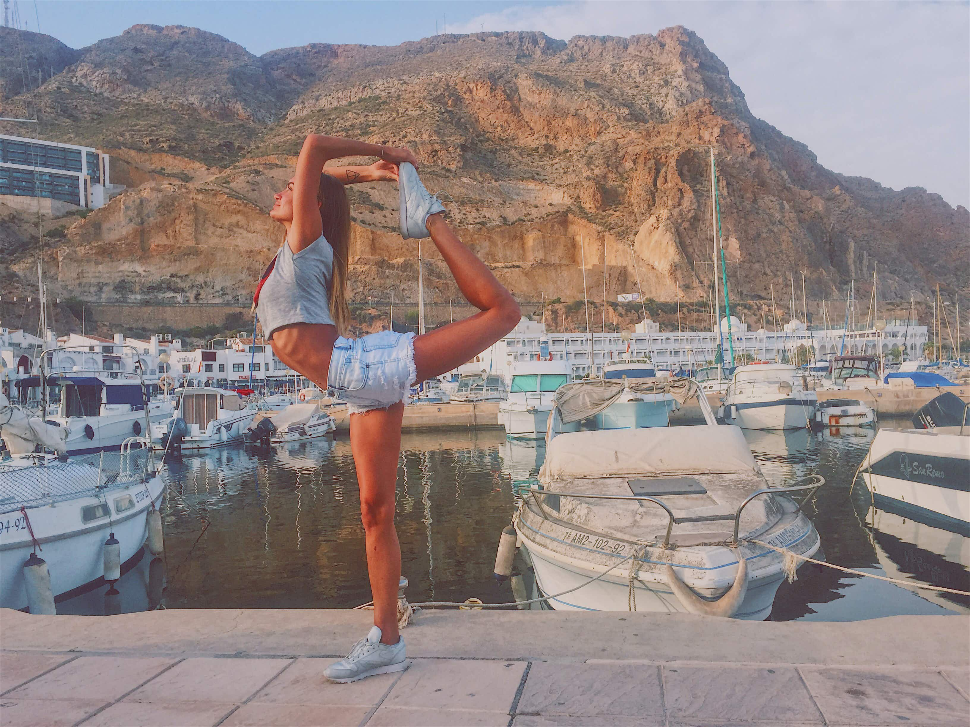 A Russian dancer is travelling the world one yoga pose at a time