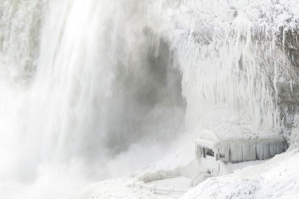 A frozen Niagara Falls is attracting tourists to a winter wonderland