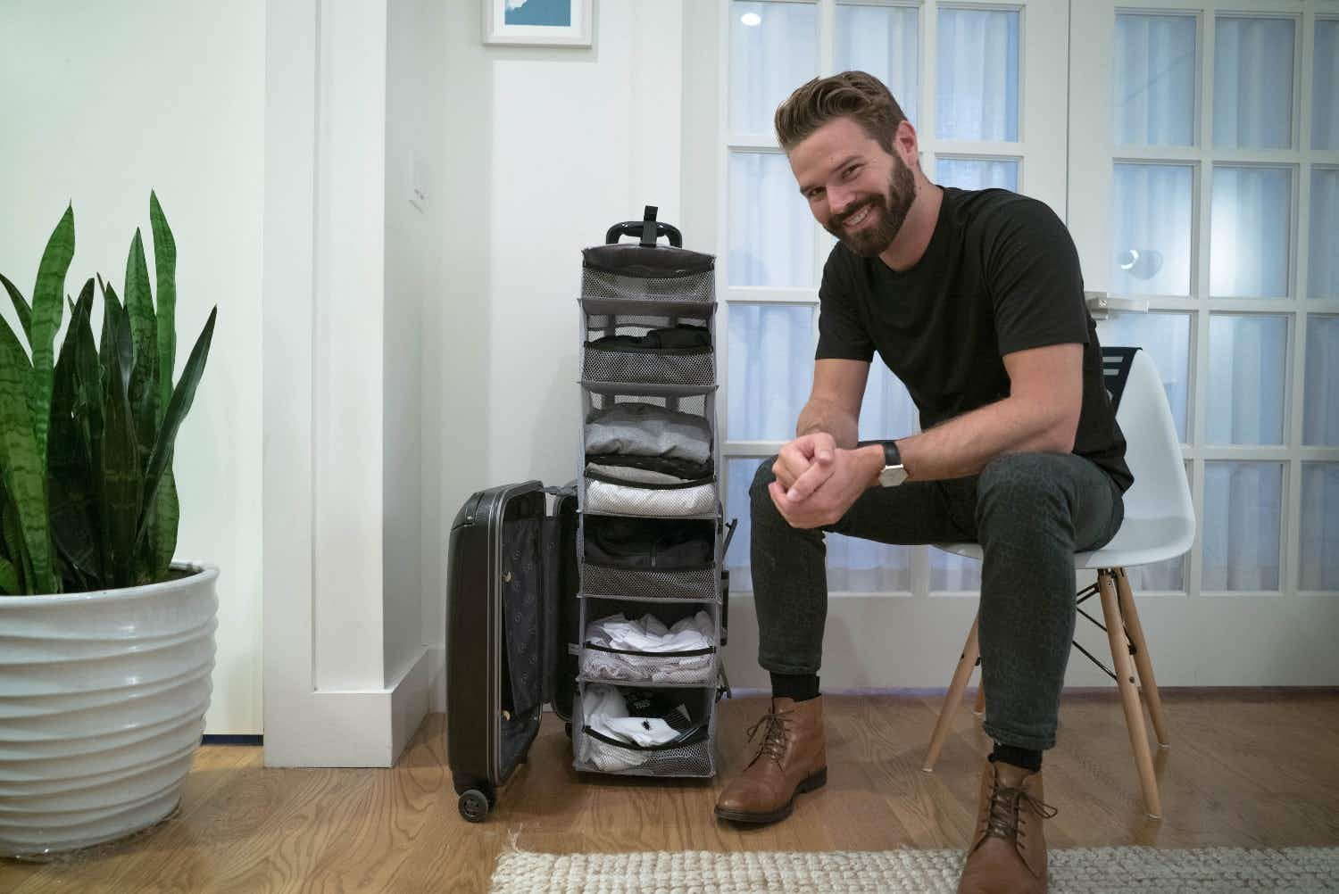 This suitcase is actually a carry-on closet that folds out into shelves