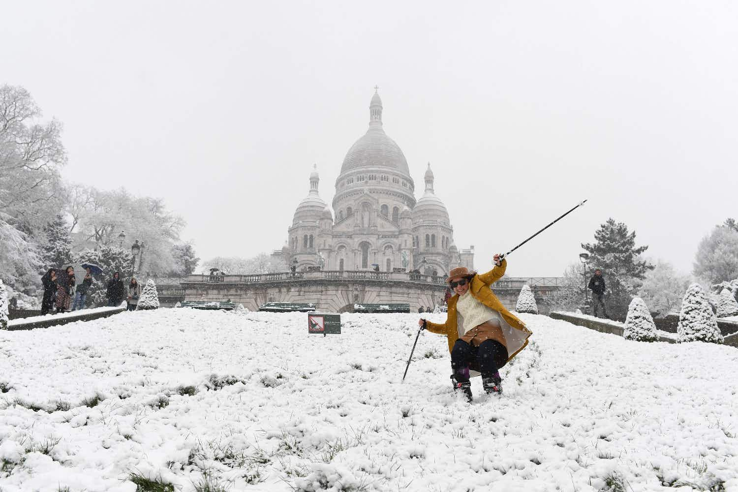 Parisians are skiing to work as a blanket of snow transforms the French capital