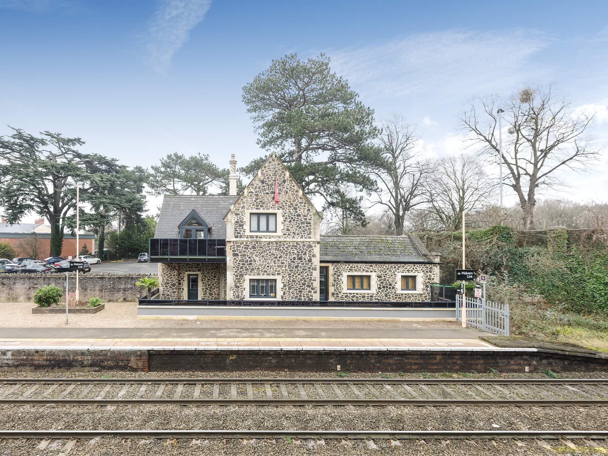 Live like a station master and stay in this charming English cottage on a busy train platform