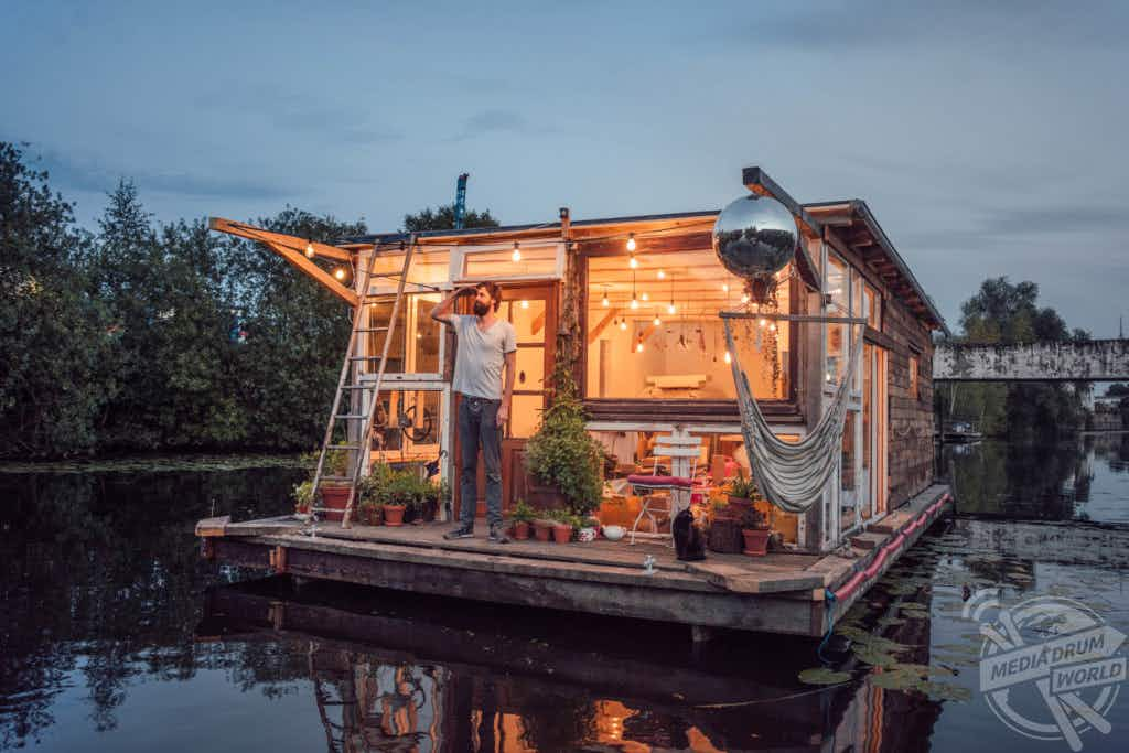 Two houseboats converted into photography studios are sailing across Europe
