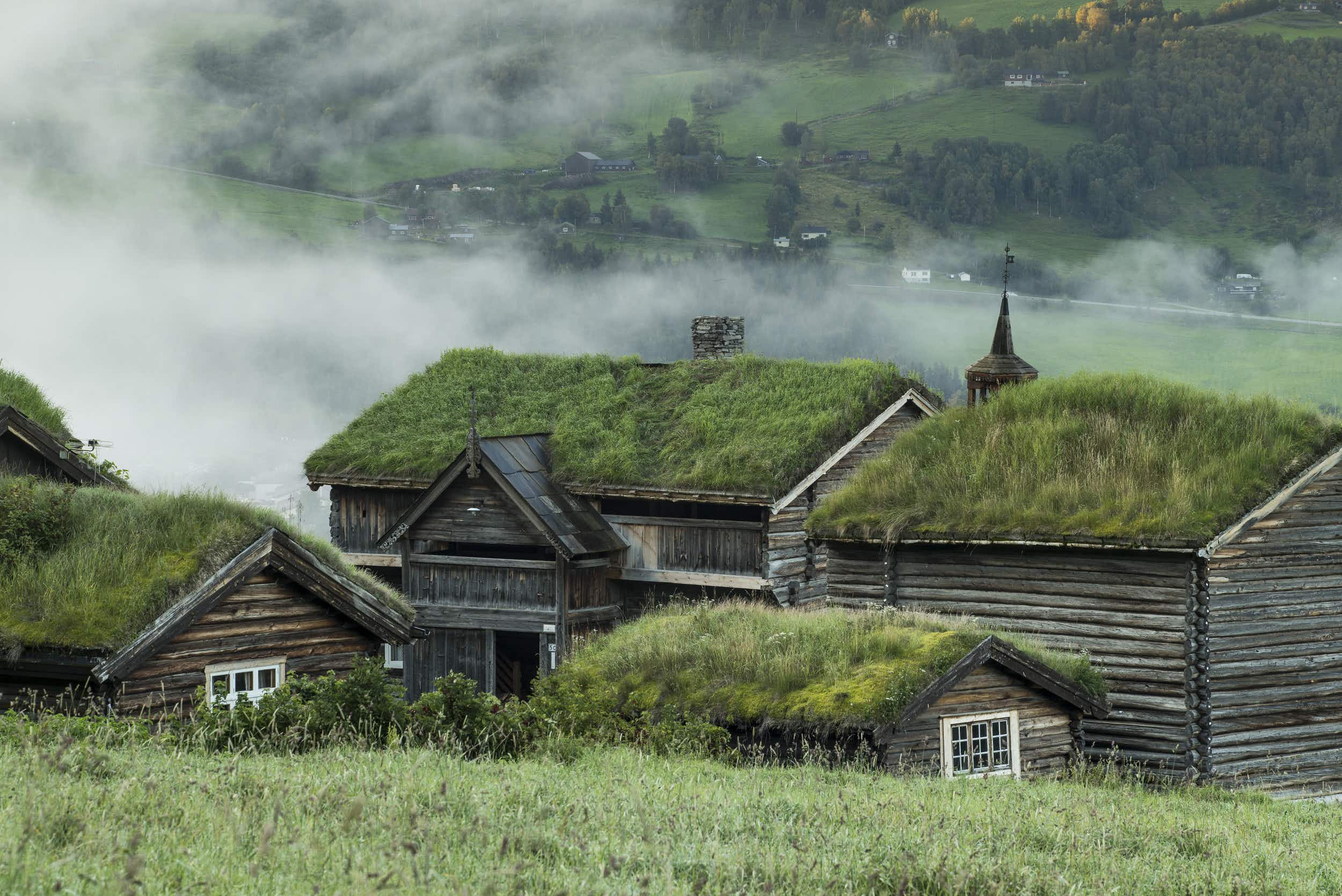 Stay in a grass-topped 17th century barn at this stunning Norwegian valley farm
