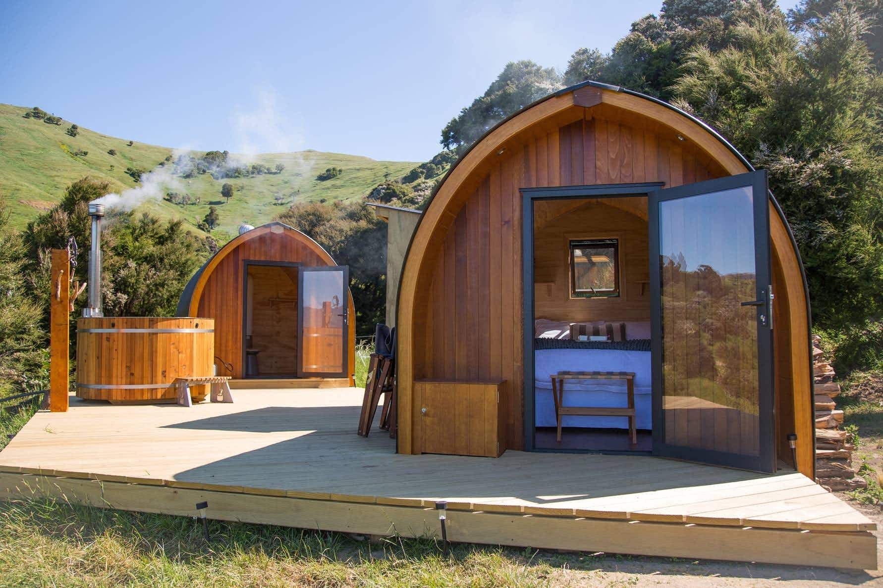 Stay in cosy pods and soak in wooden outdoor hot tubs in New Zealand