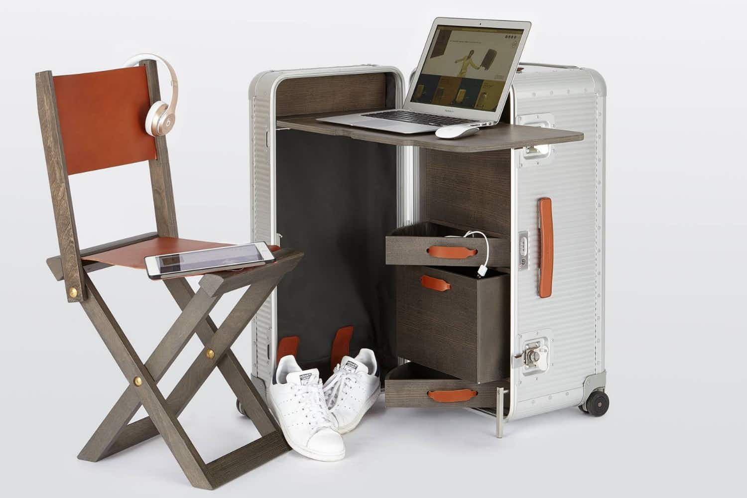 An Italian designer's luggage set contains a cooker, refrigerator, office desk, chair and bed