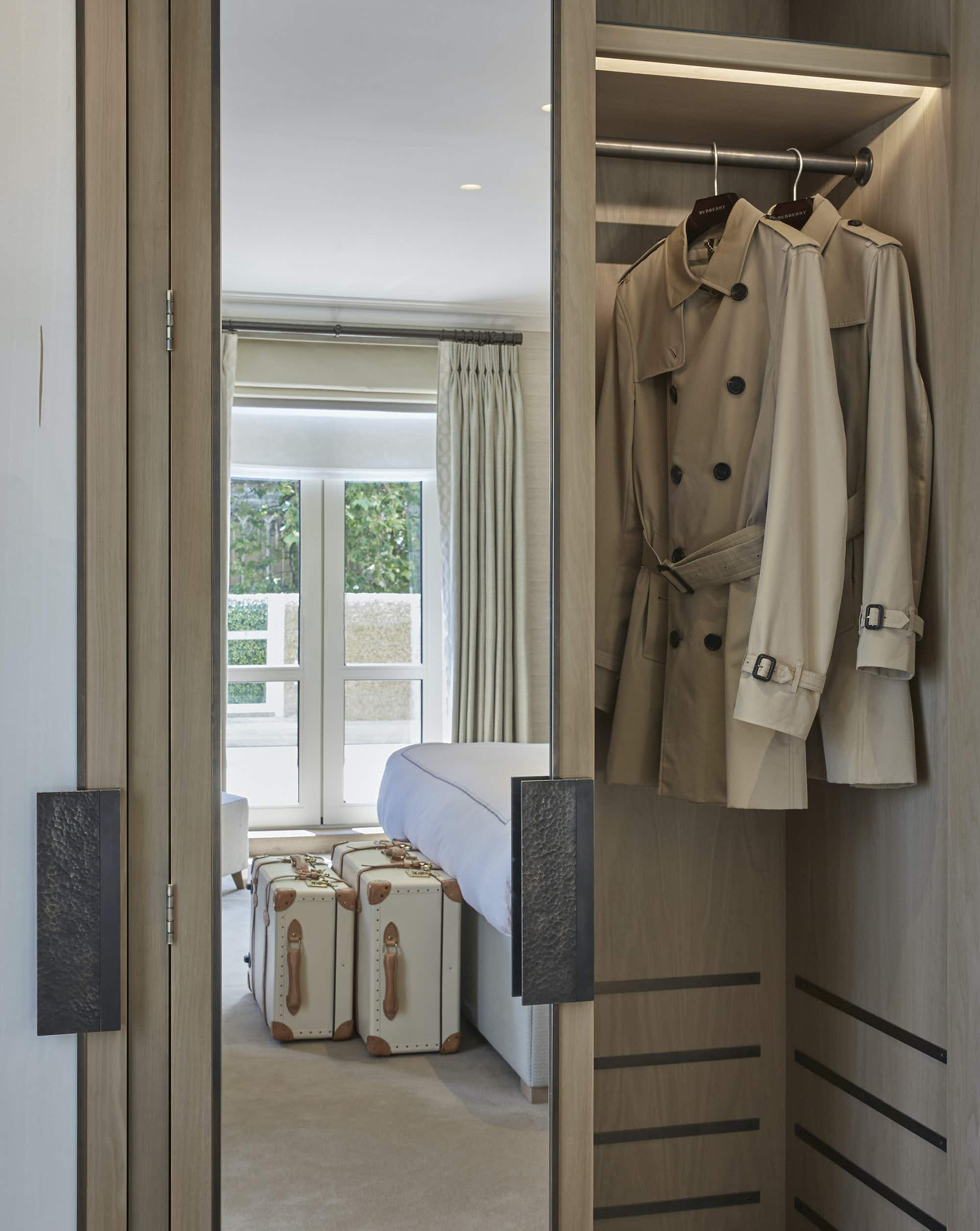 Rooms in this chic London hotel offer a Burberry trench coat for rainy British days