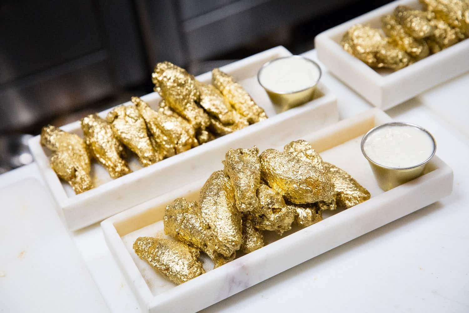 Diners in the US will be dazzled by these 24-karat gold-coated chicken wings