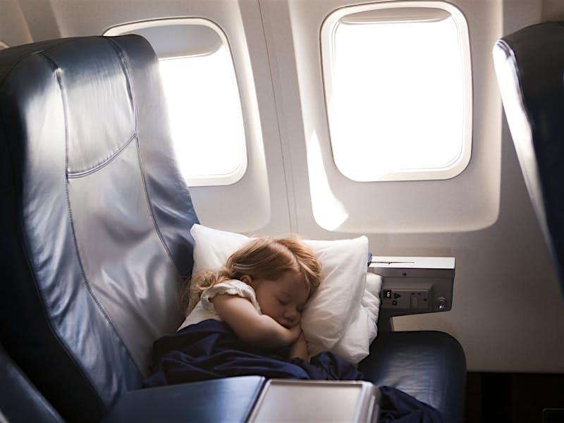 Travel News - girl (2-3) sleeping in airplane seat