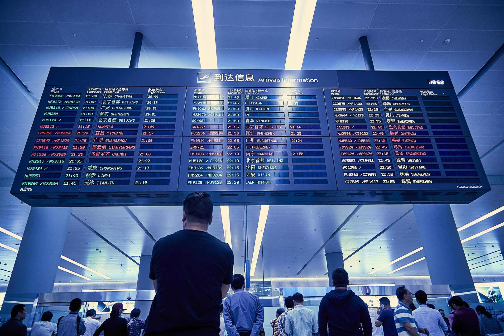Is it better to book long haul connections with the same airline when planning a trip?