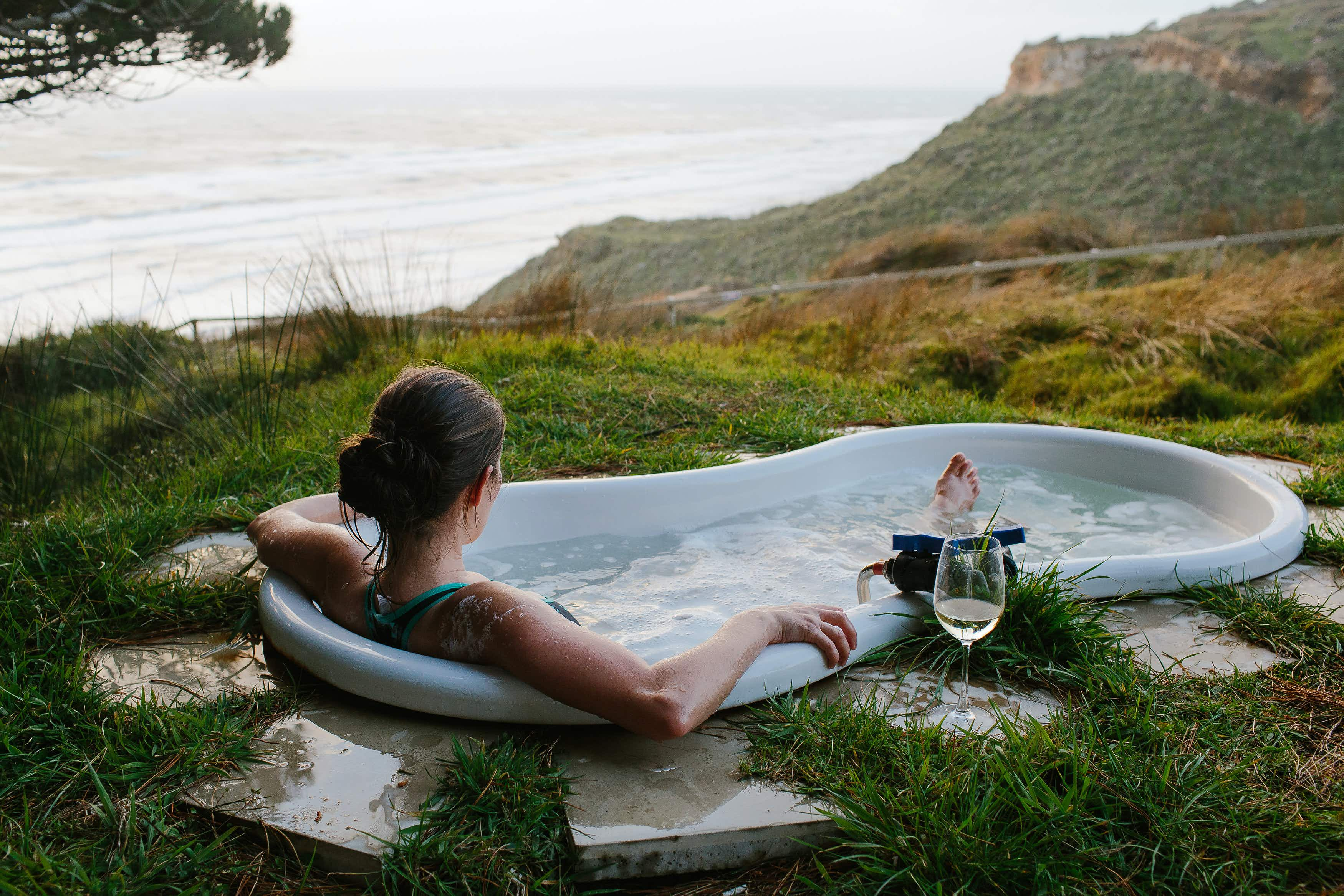 Sip wine and soak in an outdoor bath at this luxury New Zealand campsite