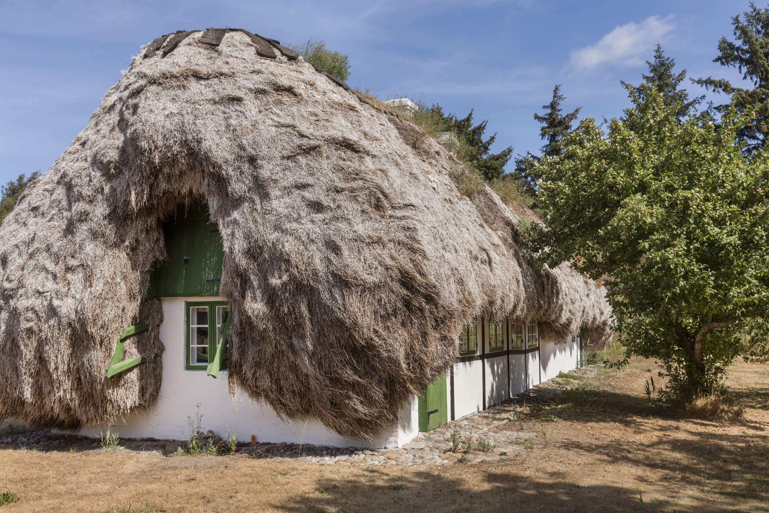 This Danish island has a historical cottage with a seaweed roof that you can rent or buy