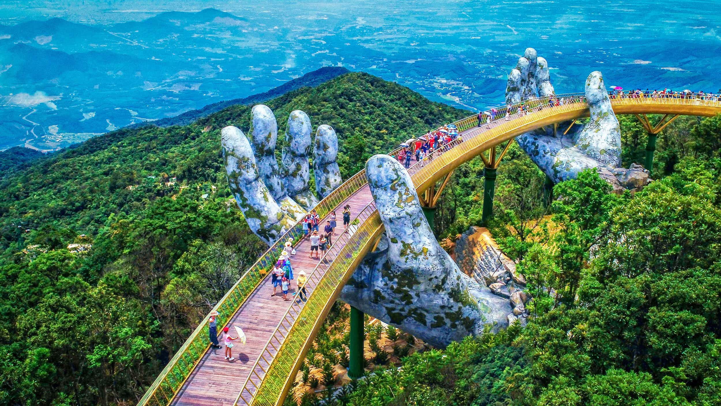 Vietnam's new golden bridge is held up by these enormous stone hands