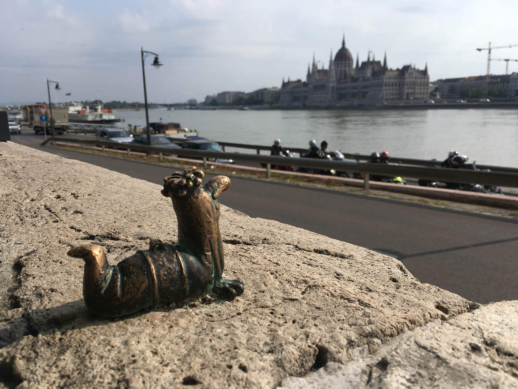 Budapest's tiny, hidden bronze statues will put a smile on your face