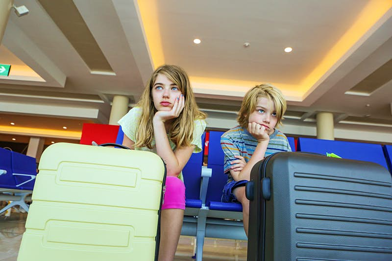 Travel News - Kids waiting for flight in airport