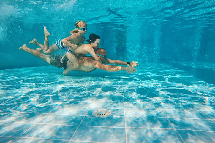 Travel News - Portrait Of Happy Family Swimming In Pool, Zakynthos Island, Greece