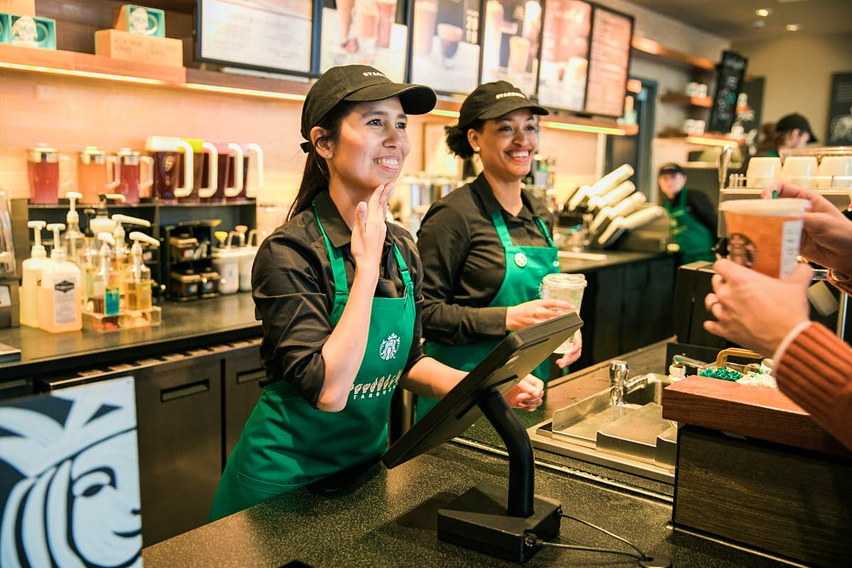 Employees at Starbucks' first 'signing store' in the US are all fluent in American Sign Language