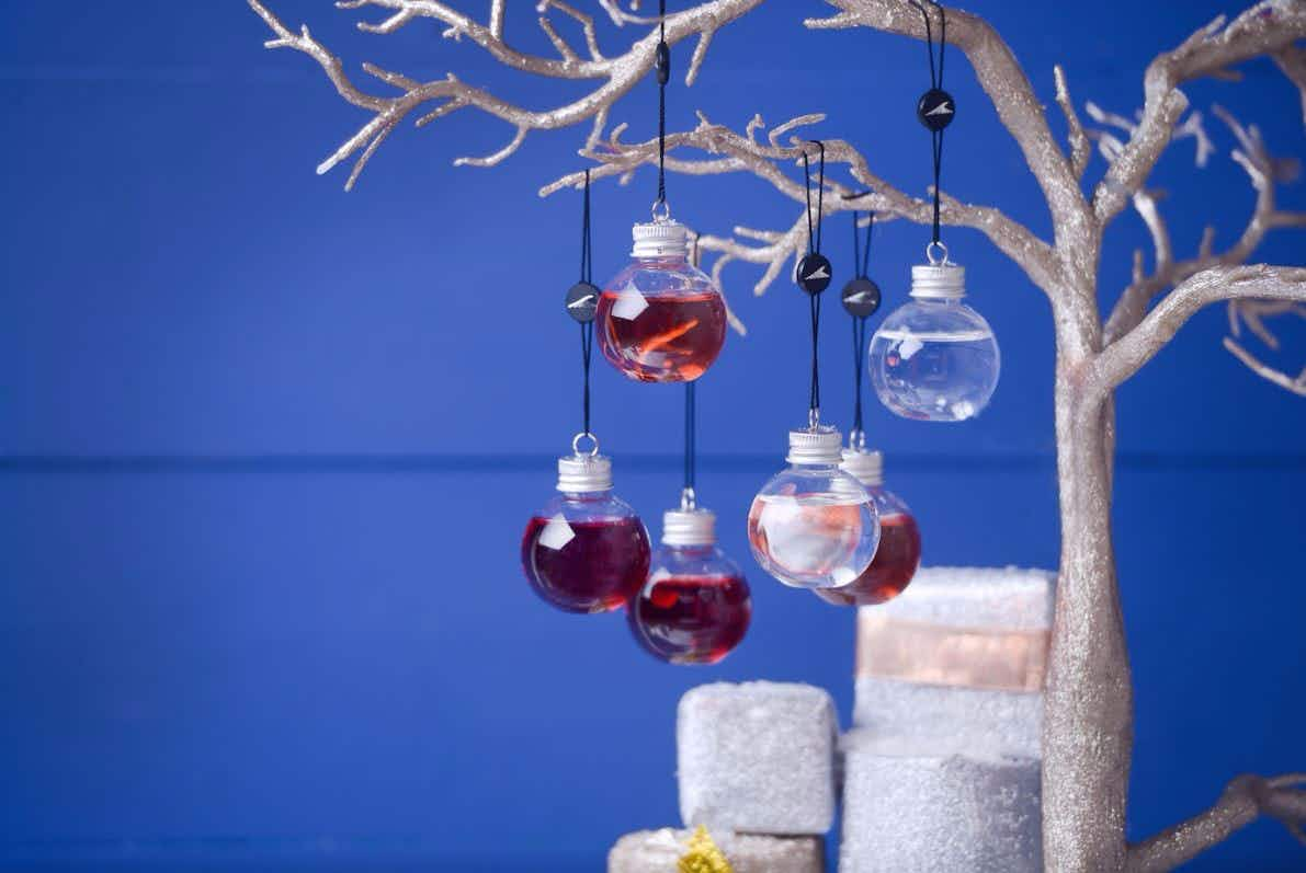 Get into the festive spirit early with these gin-filled Christmas tree baubles