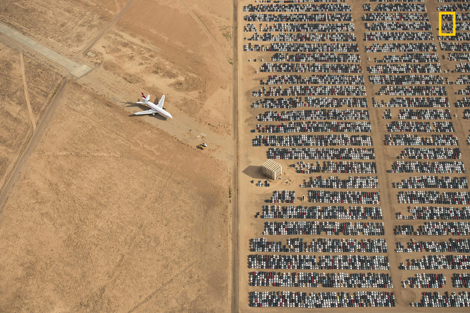"""The Grand Prize and first place in the Places category went to Jassen Todorov for his picture of thousands of Volkswagen and Audi cars sitting in the middle of the Mojave desert in California. These cars were recalled for trying to cheat US environmental tests. Todorov says that he hopes """"we will all become more conscious of and more caring towards our bautiful planet"""" also by looking at scenes like this one. Image courtesy of Jassen Todorov/2018 National Geographic Photo Contest"""