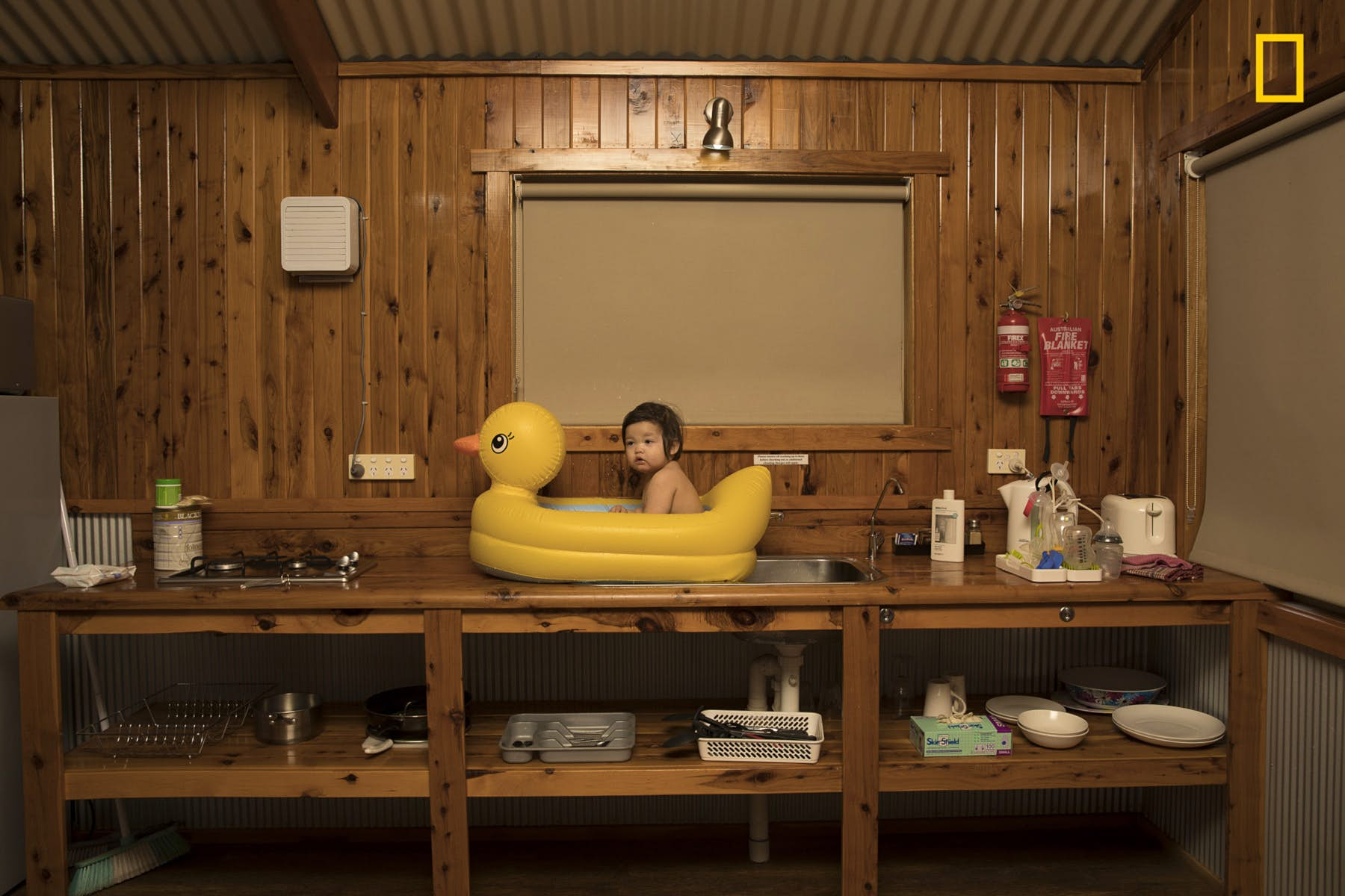 The second place in the People category went to Todd Kennedy for this shot of his youngest daughter enjoying a bath in a rubber ducky on the sink. The image was captured during a family holiday from Sydney to Uluru in Australia, when the heat became unbearable. Image courtesy of Todd Kennedy/2018 National Geographic Photo Contest