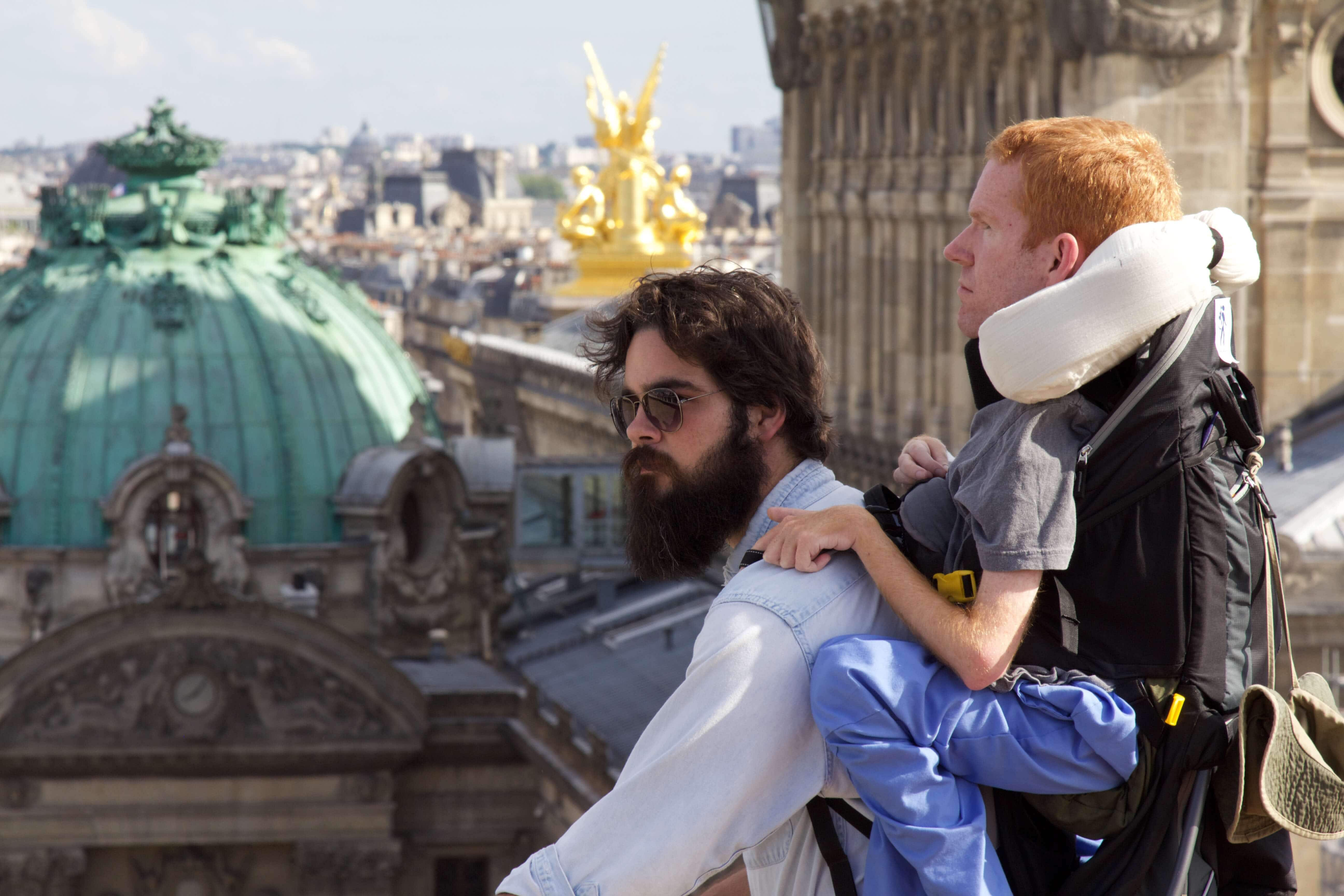 The author who travels the world as a 'human backpack'