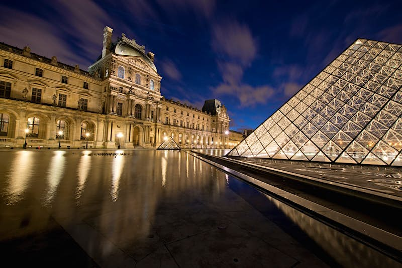 Travel News - Central courtyard of Louvre at dusk.