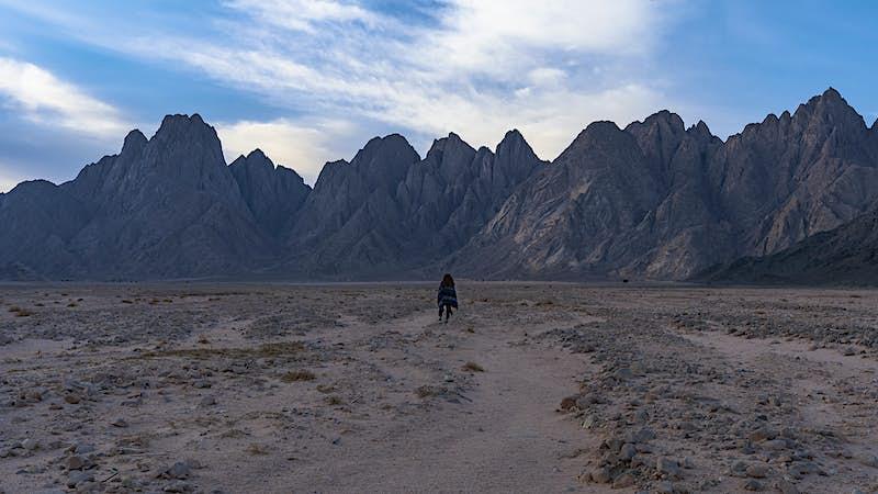 Travel News - Hiker on the Plain of El Radda, near Jebel Gattar, by NOUR EL DIN
