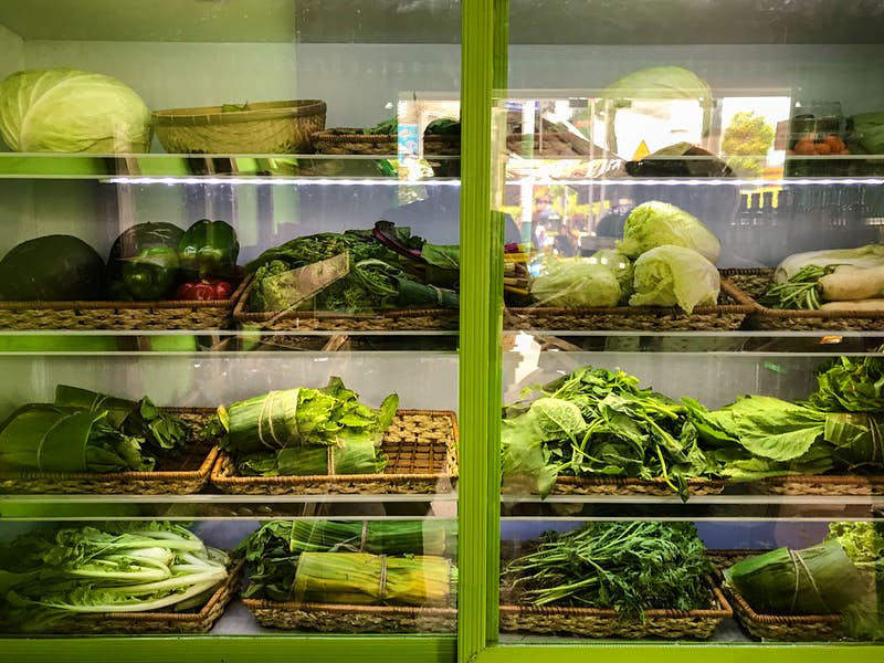 Travel News - Produce wrapped in banana leaves at Tiem Rau cua Ba in Ho Chi Minh City - Image by James Pham-1