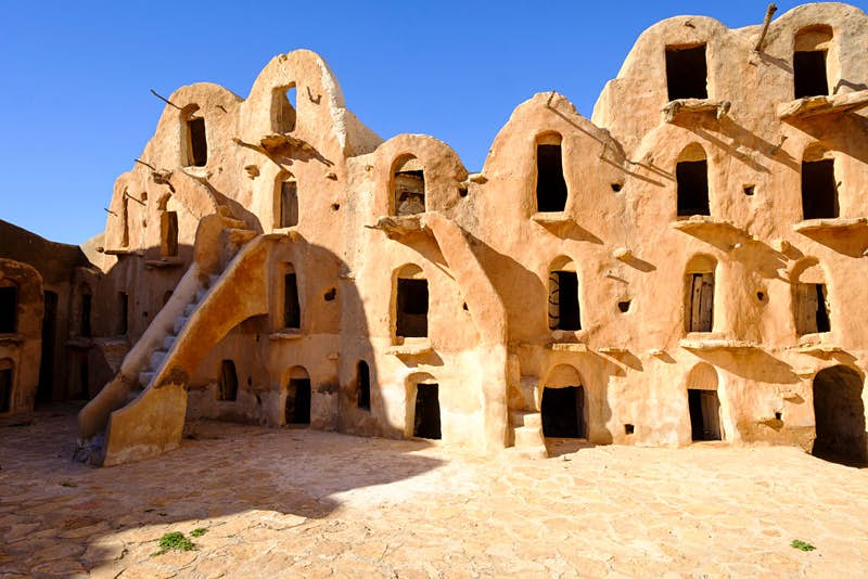 The Phantom Menace also brings us back to Tatooine, where Anakin Skywalker lived as a boy, and to Tunisia, the Earth counterpart of the sand planet. George Lucas chose the Ksar Ouled Soltane, an abandoned fortified granary dating back to the 16th century, as the location of Anakin's house, which can be found in the slave quarters of the city of Mos Espa. Photo by Thierry Monasse/Getty Images