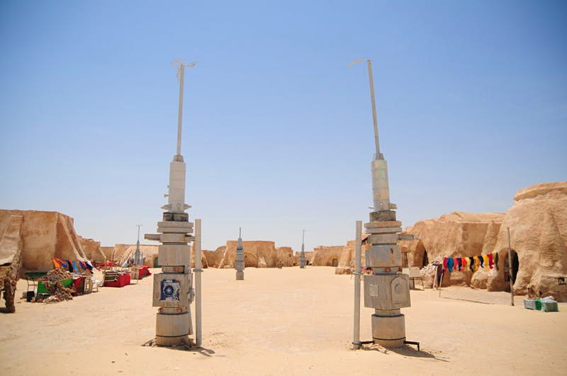 The site of Onk Jemal, in Tunisia, is where George Lucas decided to set the town of Mos Espa on Luke Skywalker's home planet Tatooine in A New Hope. The Tatooine-inspired decor built for the film are still there and very much open to visitors. Photo by Simon Kremer/picture alliance via Getty Images
