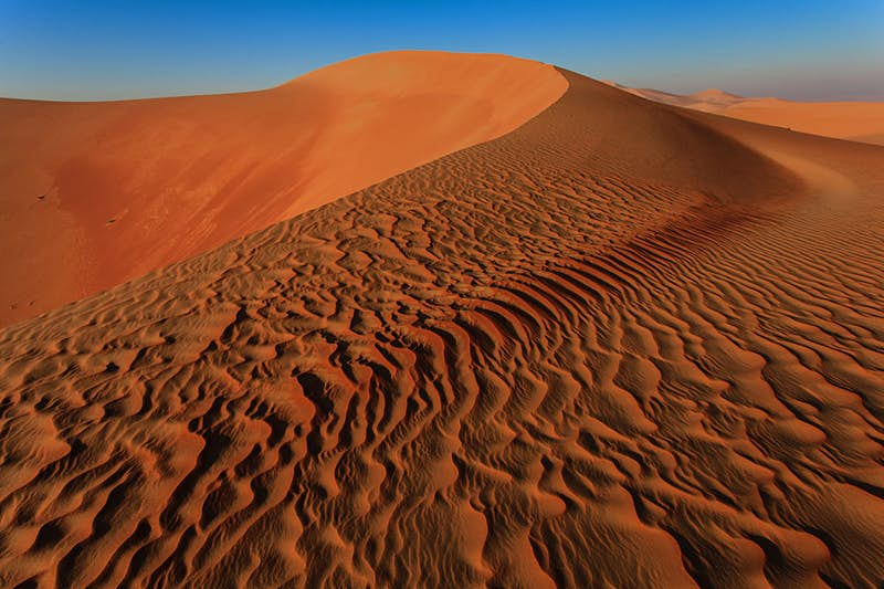 The desert of Rub' al Khali, around Abu Dhabi in the United Arab Emirates, was used in The Force Awakens as the homeplanet of the new trilogy's main character, Rey of Jakku. Photo by Achim Thomae/Getty Images