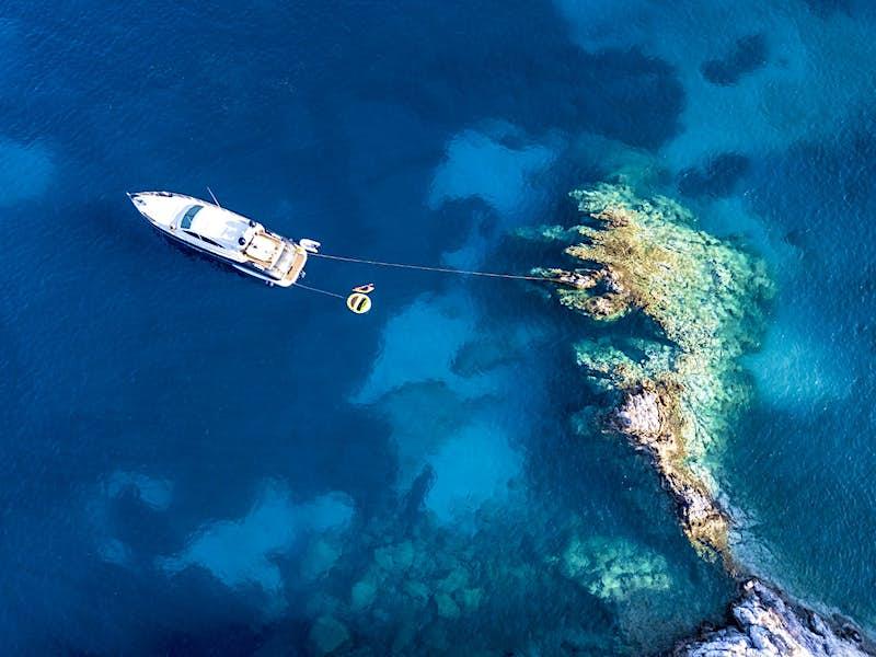 An aerial shot of the chartered Eudemonia Kyvos off Polyaigos island