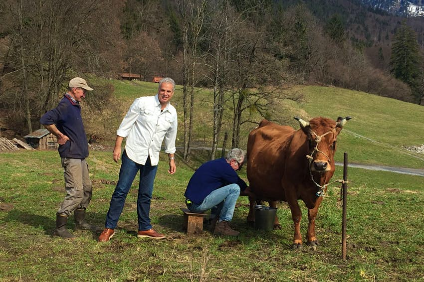 Antthony Bourdain milking a cow in the French Alps