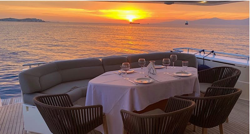 the deck of the Armonia at sunset