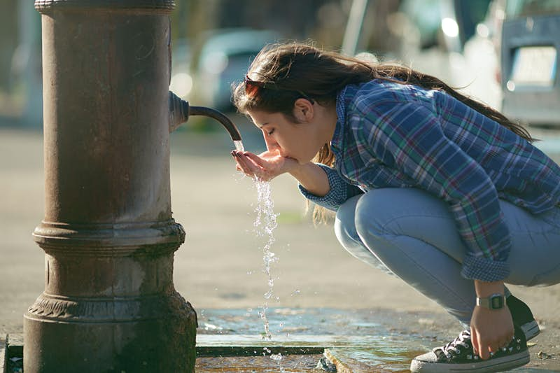 Travel News - Young girl drinking water