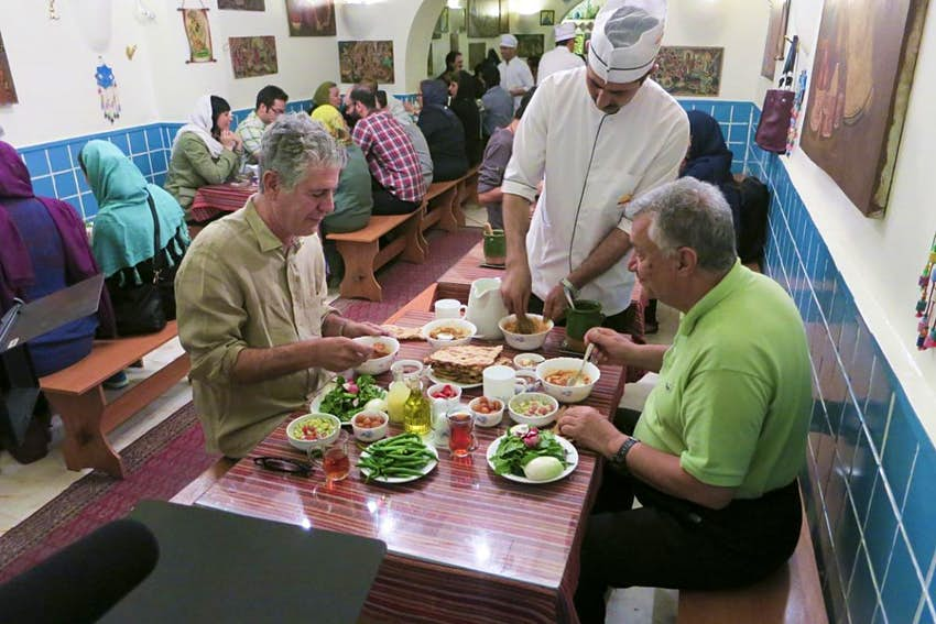 Anthony Bourdain dining with a companion in Iran.
