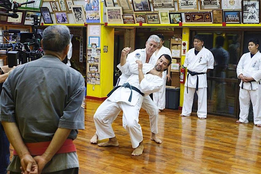 Anthony Bourdain attempting tegumi wrestling in Okinawa, Japan.