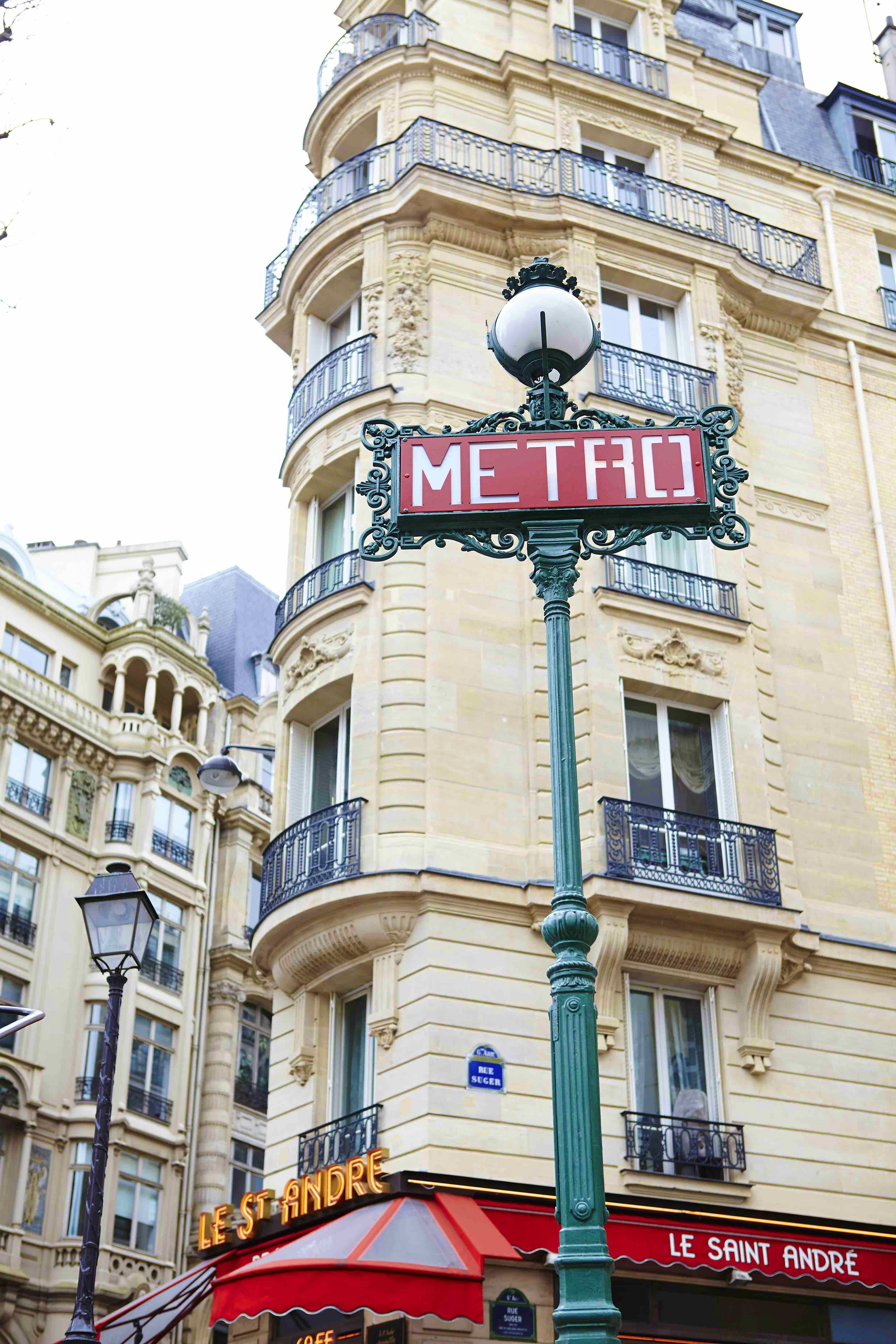 Travel News - Metro sign on corner of Rue Seger with Le Saint Andre in background.