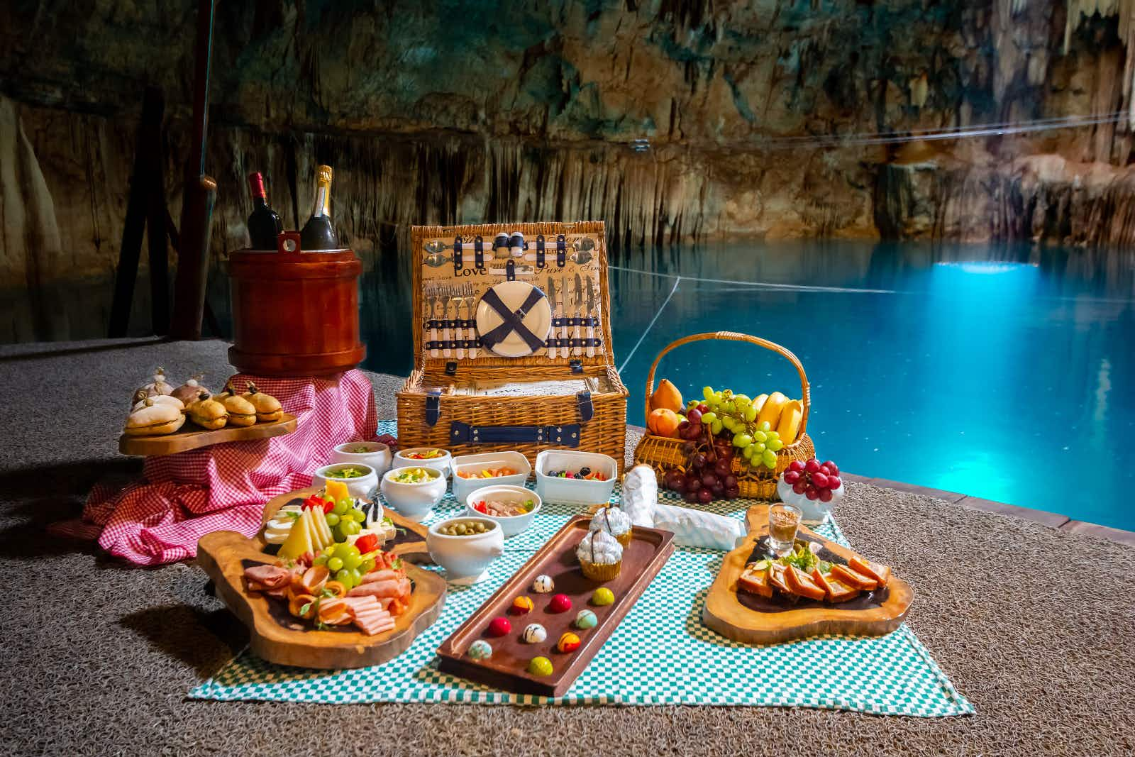 Head underground to wine and dine in a magical Mexican cenote in Playa del Carmen