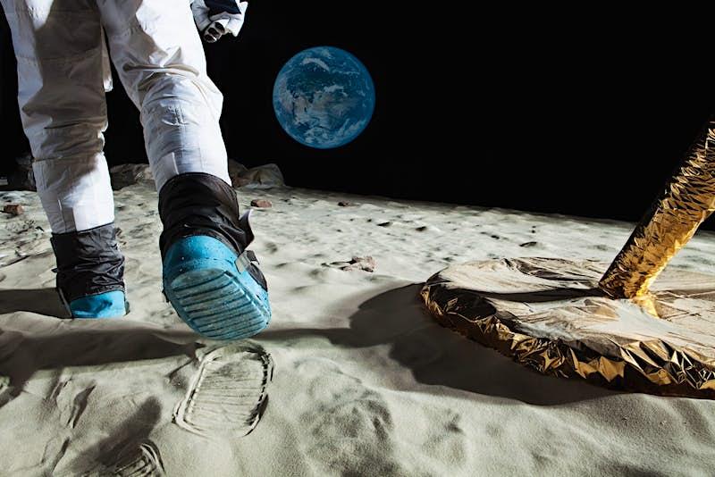An astronaut walking on the moon