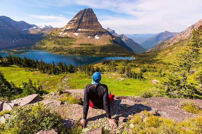 Hiker takes a break on the rocks in Glacier National Park.