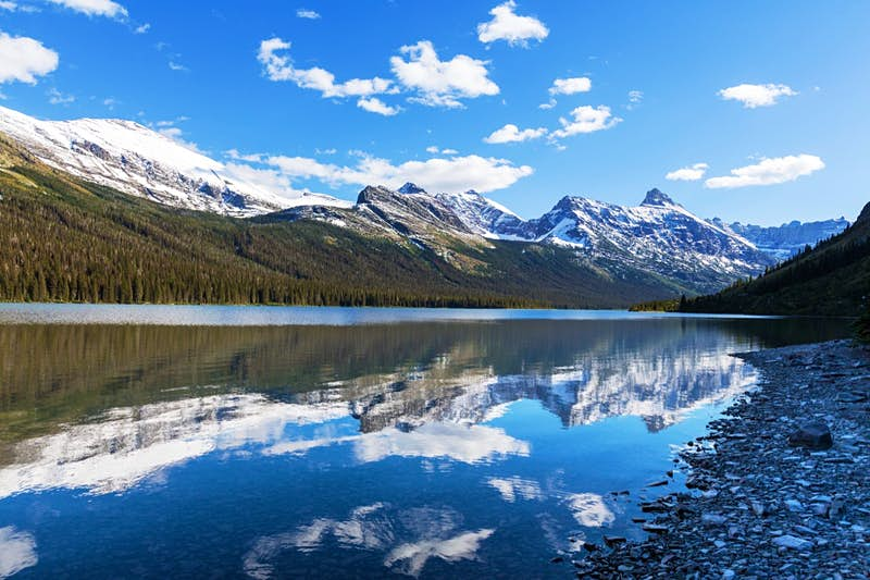 A mountain range reflected in a lake at Glacier National Park.